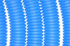 Blue plastic corrugated pipes Stock Photos