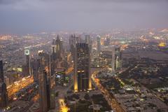 DUBAI, UAE-JANUARY 19: View from Burj Khalifa on January 19, 2014 in Dubai, U - stock photo