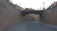 Man walking his dog and a car passing under Liars Bridge, Sibiu Stock Footage