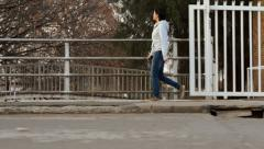 Chinese woman walking in small town Stock Footage
