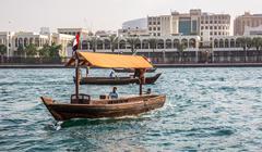 DUBAI, UAE-JANUARY 18: Traditional Abra ferries on January 18, 2014 in Dubai, Stock Photos