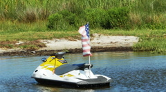 American Flag Blowing in Wind on Jet Ski on Bay in Slow Motion - stock footage