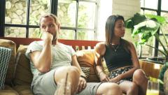 Relationship difficulties, conflicted couple on sofa at homeHD Stock Footage
