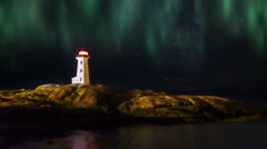 Aurora Borealis viewed over Peggy's Cove lighthouse Stock Footage