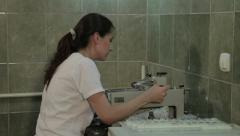 Young female pathologist cuts and takes tissue sample for analyzing in the lab. Stock Footage