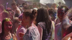 Multicolored Crowd of Blondes Painting Each Other and Dancing at Holy Festival Stock Footage