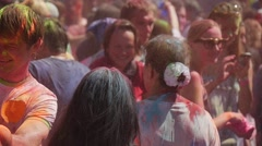 Multicolored Crowd of Youngsters Painting Each Other and Dancing at Holy Stock Footage