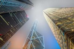 Looking up Hong Kong skyscrapers and office buildings Stock Photos