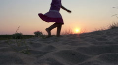 Silhouette of a dancing little girl against the sunset sky, Slow Motion - stock footage