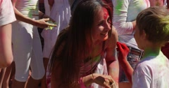 Small Boy Painting a Teenage Girl With Red Paint, While Attending a Holy Stock Footage
