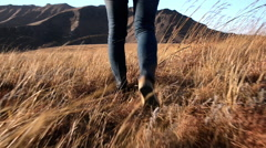 Woman hiking outdoors Stock Footage