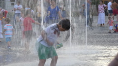 Boy playing near a water fountain in Large Square, Sibiu Stock Footage