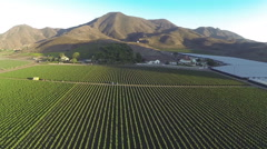 Aerial fly over Farmland sunset golden hour ranch farm mountains Stock Footage