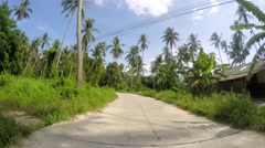 Driving on Motorbike on Rural Road in Jungle. Time Lapse Stock Footage