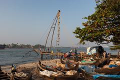 Stock Photo of KOCHIN, INDIA-FEBRUARY 24: Fishermen on the city port on February 24, 2013 in