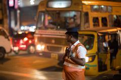 CHENAI, INDIA-FEBRUARY 9: Indian bus 9, 2013 in Chenai, India. The policeman  - stock photo