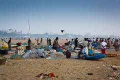 Stock Photo of CHENNAI, INDIA-FEBRUARY 10: Fishermen on the beach Marina Beach on February 1