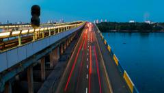 Night road traffic timelapse on a bridge across Dnieper river in Kyiv, Ukraine Stock Footage