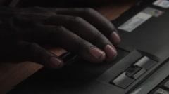 Boy taps n scroll on laptop Stock Footage