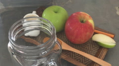 Pouring homemade apple smoothies into glass Stock Footage