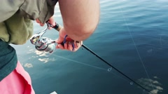 Fisherman doing some spinning in a beautiful lake - stock footage