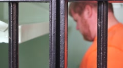 Prisoner Behind Bars With Regrets Stock Footage