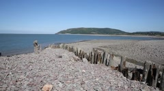 Porlock Weir beach Somerset coast England UK in summer PAN Stock Footage