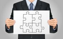 businessman holding blank puzzle poster - stock illustration