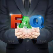 businessman holding FAQ words - stock illustration