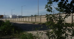 Two Meter Hign Concrete Wall With Barbed Wire on It, Protecting the Oil Storage Stock Footage
