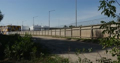 Long Concrete Fence With Barbed Wire on It, Protecting the Oil Storage Stock Footage