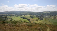 View of Porlock Somerset from walk to Bossington PAN Stock Footage