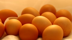 Eggs on white surface rotating Stock Footage