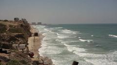 Waves break on shore in summer, Mediterranean sea in Herzliya, Israel Stock Footage
