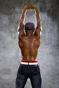 Urban Man Flexing Back Muscles - stock photo