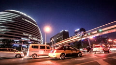 The panning night view of Galaxy SOHO shopping mall in Beijing, China Stock Footage