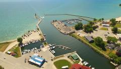 Stock Video Footage of Bustling Harbor Town on Lake Michigan, Aerial View