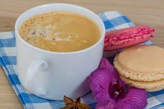 Capuccino with macaroons - stock photo