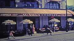 1969: Scenes around Paris of popular restaurants and from above the city. - stock footage