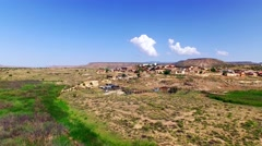Small western-style town on a dry hill Stock Footage