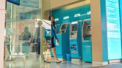 Stock Video Footage of Bank Clients Using Automatic Teller Machines - ATM. Timelapse
