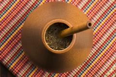 Calabash and bombilla with yerba mate - stock photo