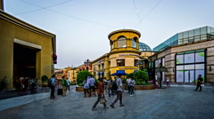 Panorama view of people stroll in the European style shopping center in Beijing Stock Footage