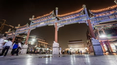 The night view of people stroll in the Qianmen shopping street in Beijing Stock Footage