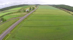 Aerial view of road between fields in Gaspe Peninsula Stock Footage