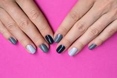 Delicate female hands with a stylish neutral manicure Stock Photos