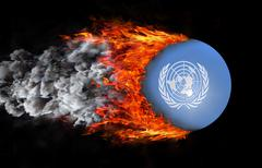 Flag with a trail of fire and smoke - United Nations Stock Illustration