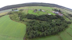 Aerial view over crop fields in Gaspe Peninsula Stock Footage