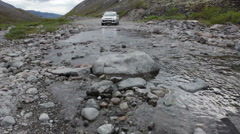 SUV standing in front of mountain river for forcing, Khibins in Kola Peninsula,  Stock Footage