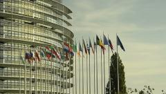 Panning over European Parliament building to all European Union Countries flags Stock Footage